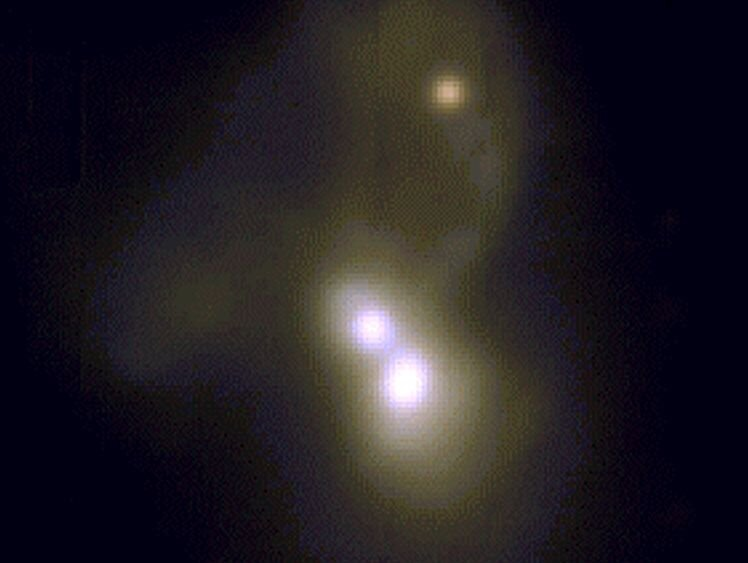 Астрономи показали злиття потрійний галактики з двома надмасивними чорними дірами